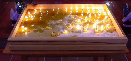 Candles lit by recipients of organs, after the service.